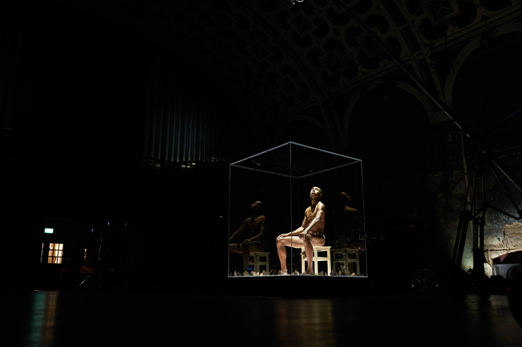 Capture of Miles Greenberg's performance, with the artist wearing sparkling lace-up Ludovic de Saint Sernin briefs.