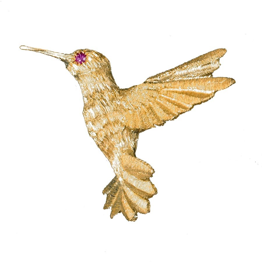 Inauguration Fashion 2021: Scully and Scully 18k yellow gold bird brooch with ruby eye, $1,400
