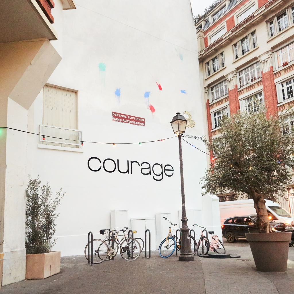 The Courrèges New Year's advertisement on a wall in Paris.