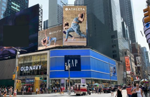 The Athleta billboard going up in Times Square in February.
