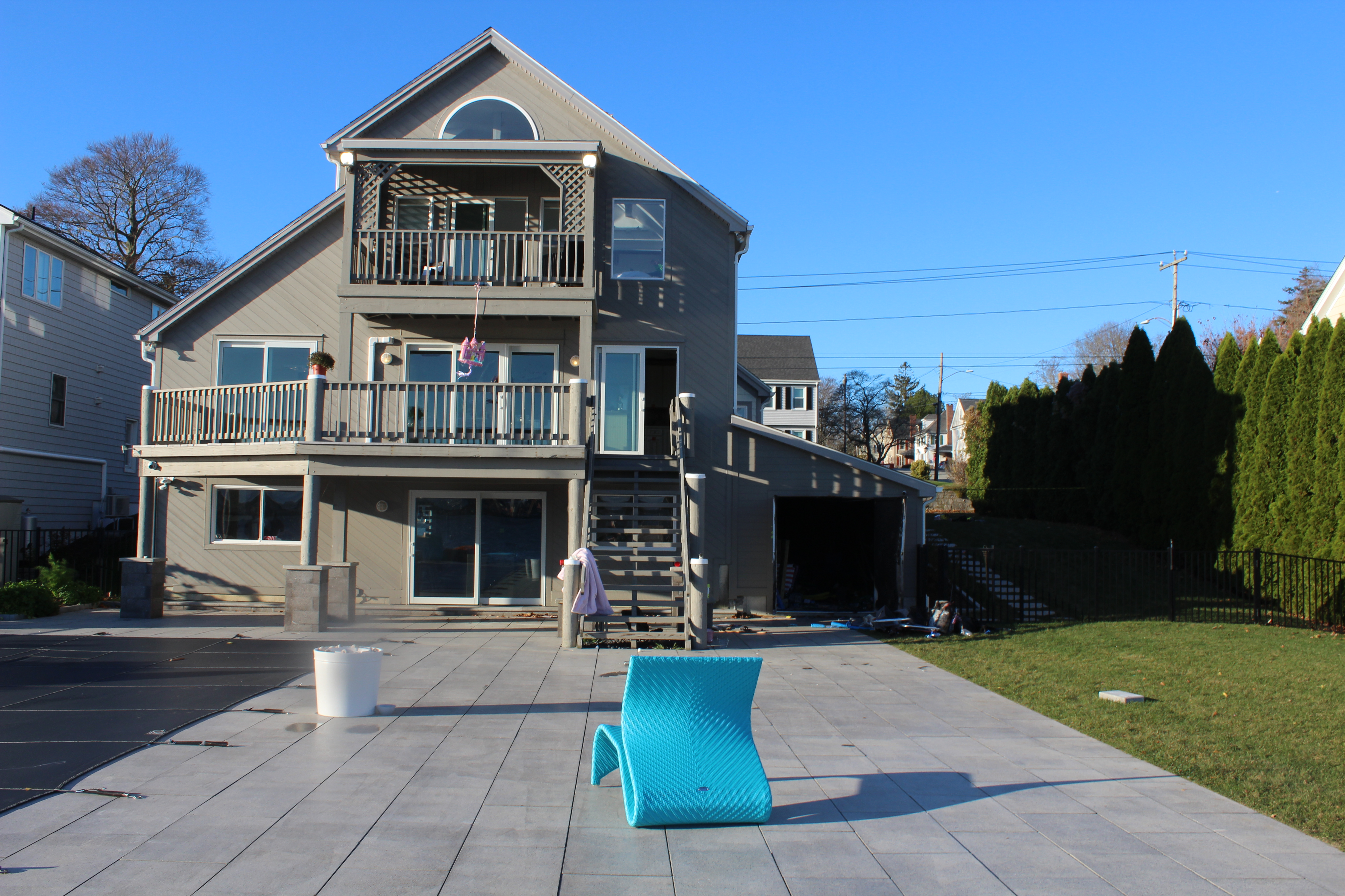 The pool shed at 500 Pequot Avenue is attached to the rear of the house.