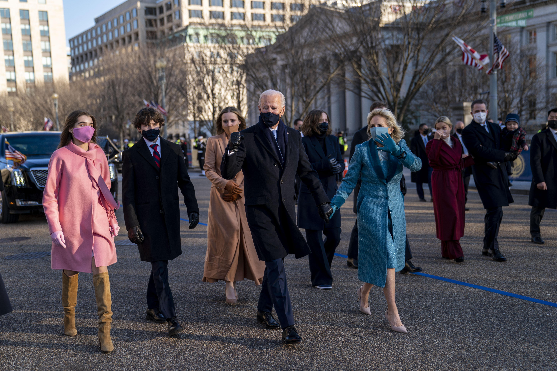 President Joe Biden, First Lady Jill Biden and family, walk near the White House during a Presidential Escort to the White House, Wednesday, Jan. 20, 2021 in Washington. (Doug Mills/The New York Times via AP, Pool)