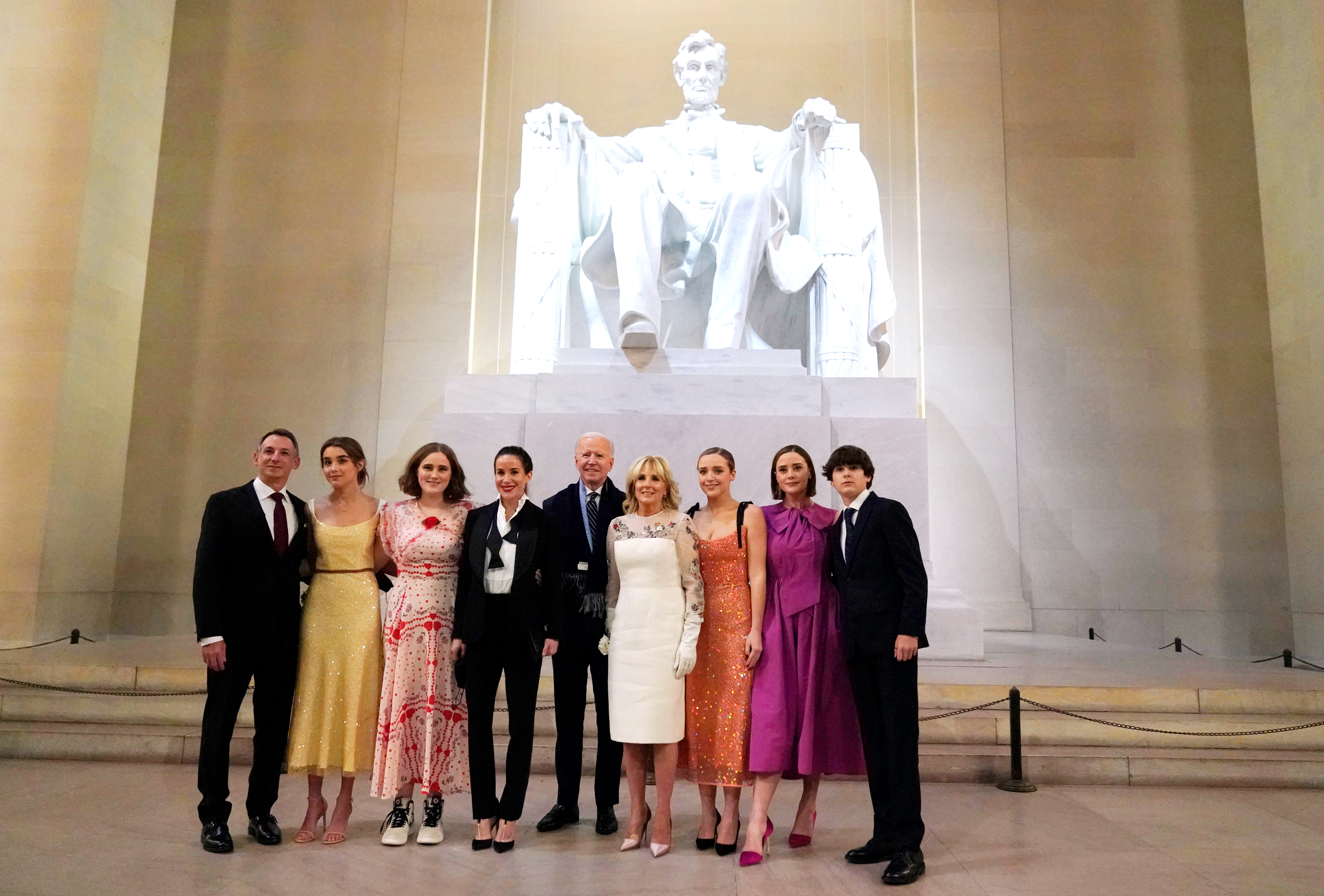President Joe Biden and first lady Jill Biden pose for a photo with family members at the Celebrating America concert at the Lincoln Memorial in Washington, Wednesday, Jan. 20, 2021, after his inauguration.. (Joshua Roberts/Pool photo via AP)