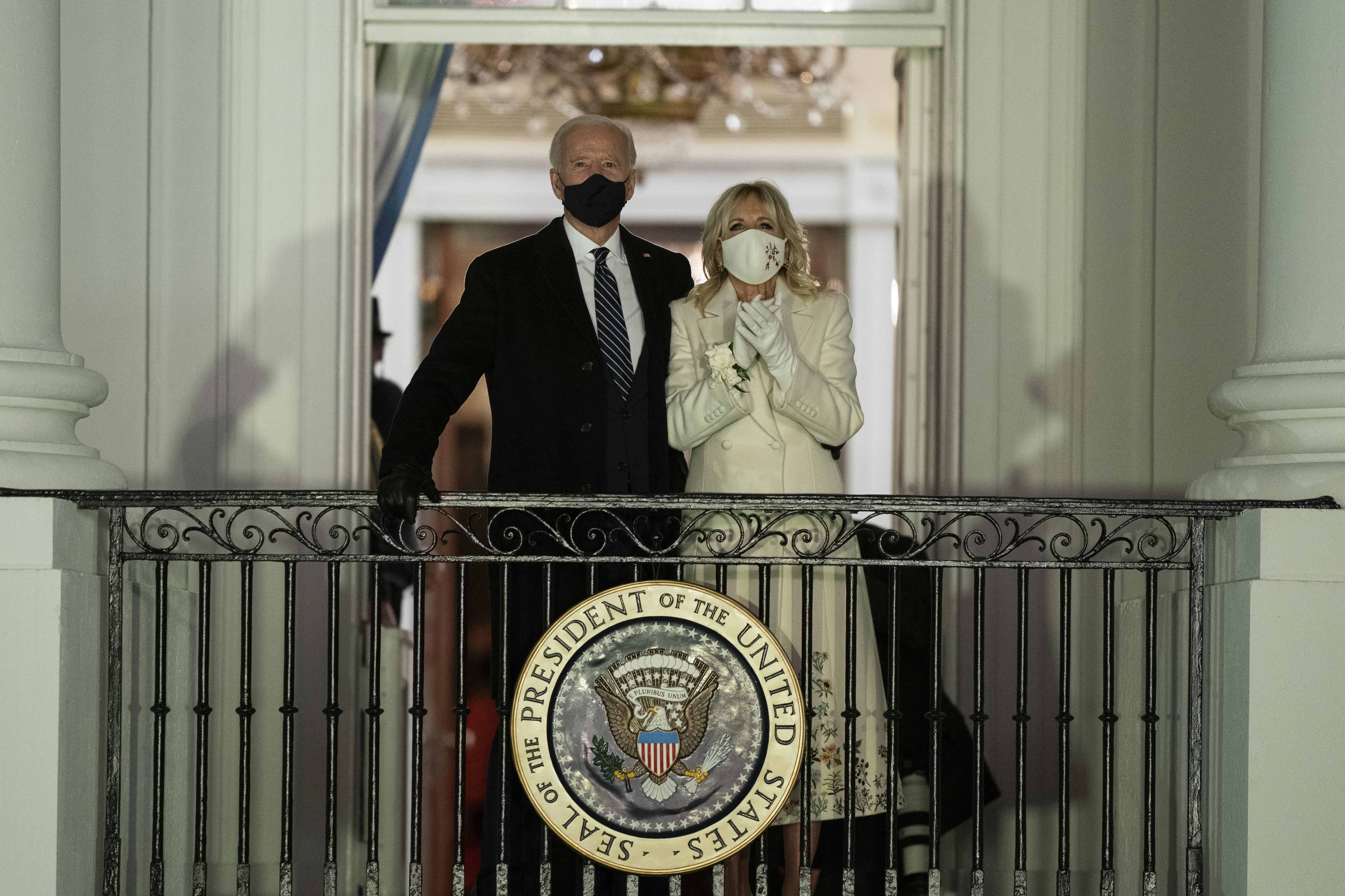 President Joe Biden and first lady Jill Biden watch fireworks from the White House, Wednesday, Jan. 20, 2021, in Washington. (AP Photo/Evan Vucci)
