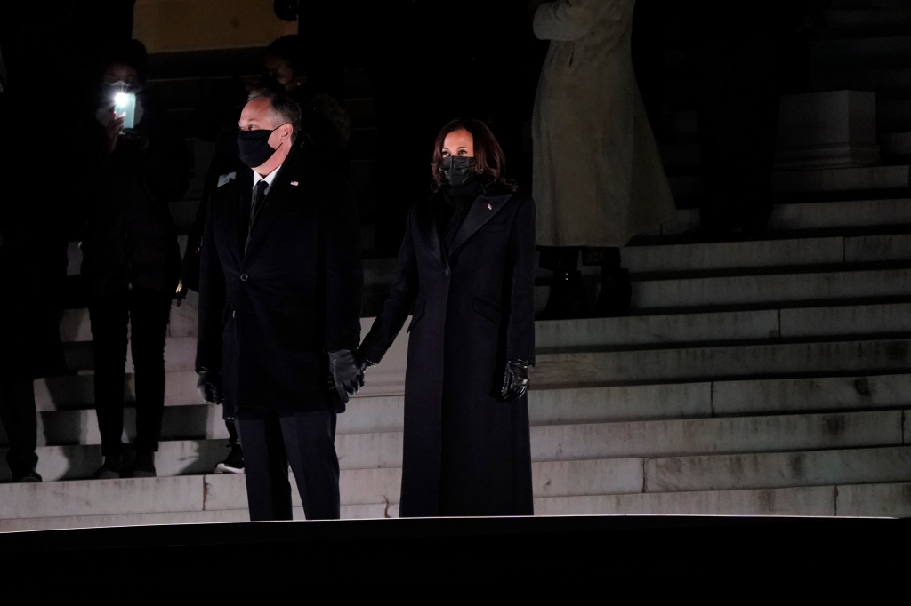 Vice President Kamala Harris holds hands with her husband Doug Emhoff before watching fireworks at the Lincoln Memorial, Wednesday, Jan. 20, 2021, in Washington. (AP Photo/Jacquelyn Martin)