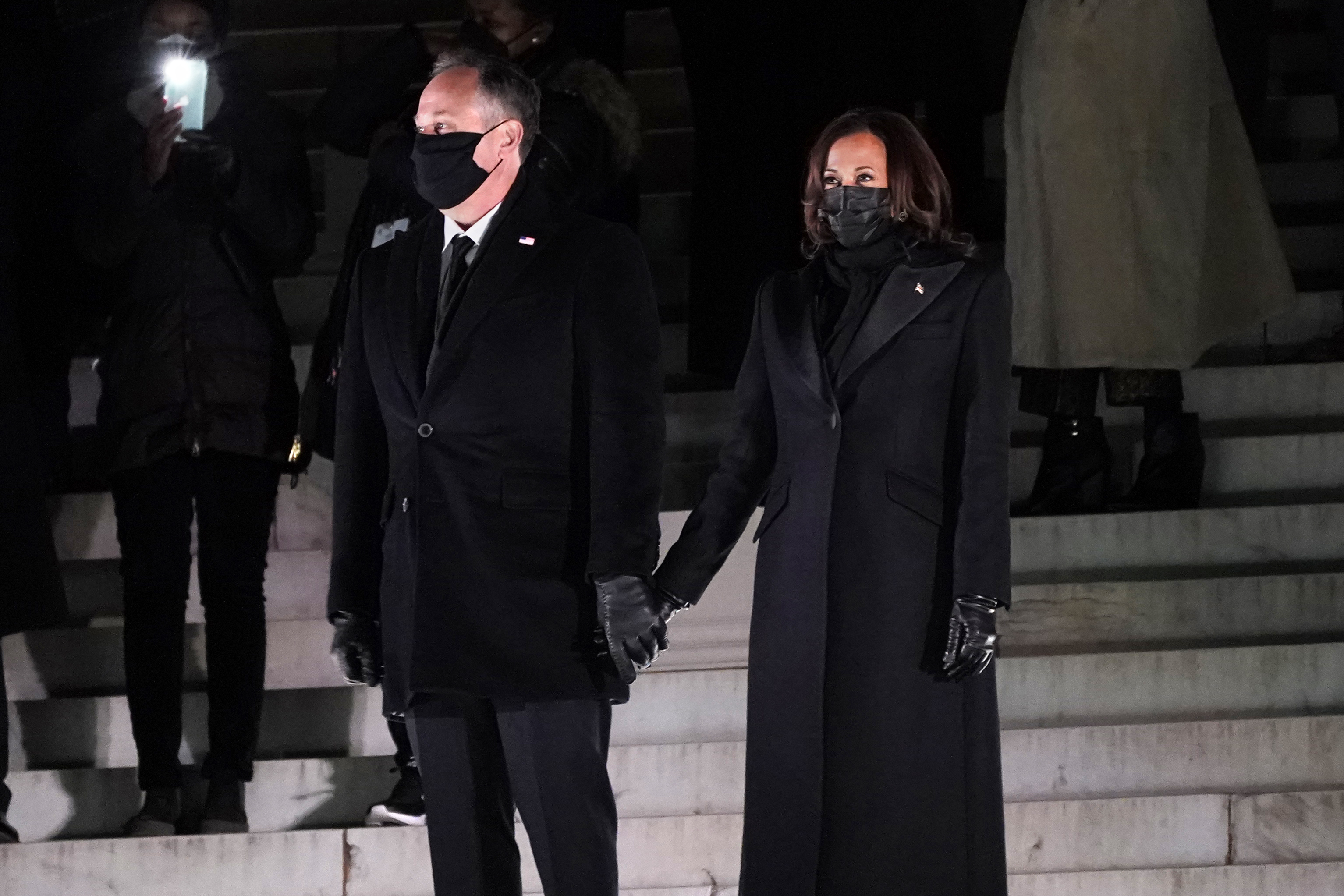 Vice President Kamala Harrisholds hands with her husband Doug Emhoff before watching fireworks at the Lincoln Memorial, Wednesday, Jan. 20, 2021, in Washington.(AP Photo/Jacquelyn Martin)