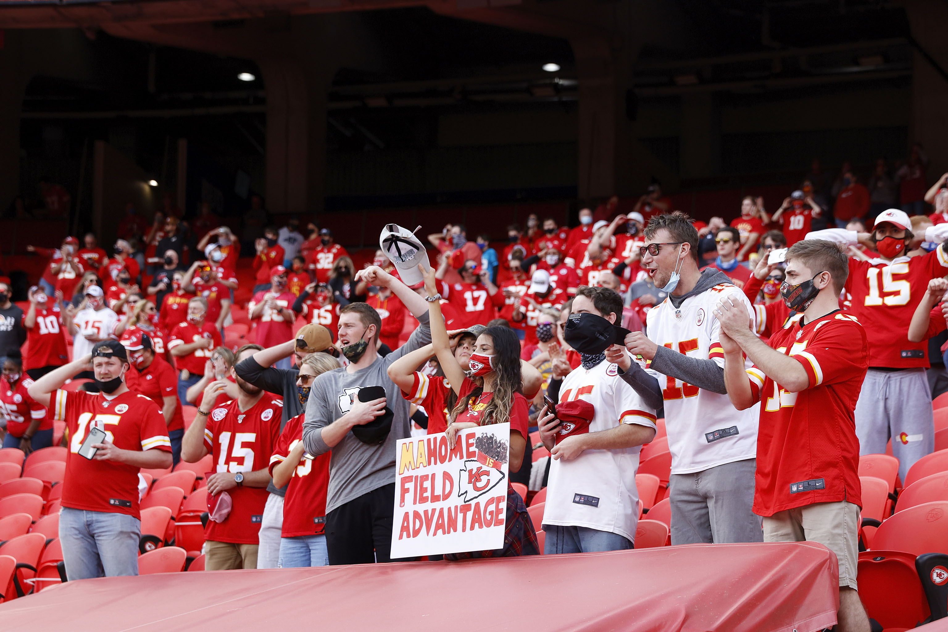 A group of Kansas City Chiefs fans seen cheering.