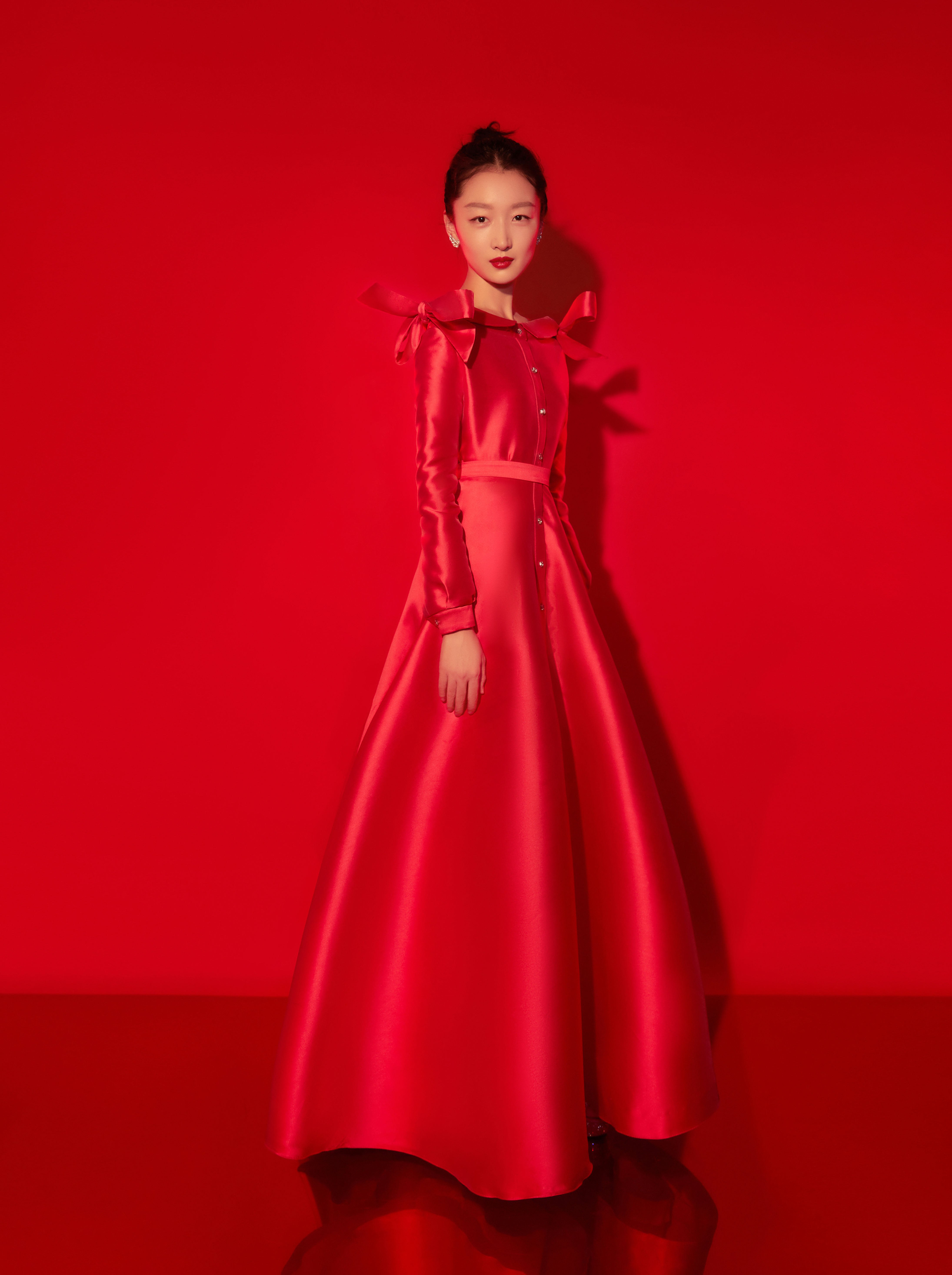 Actress Zhou Dongyu wears Alexis Mabille haute couture and Boucheron Plume de Paon earrings and ring for the Spring Festival Gala 2021.
