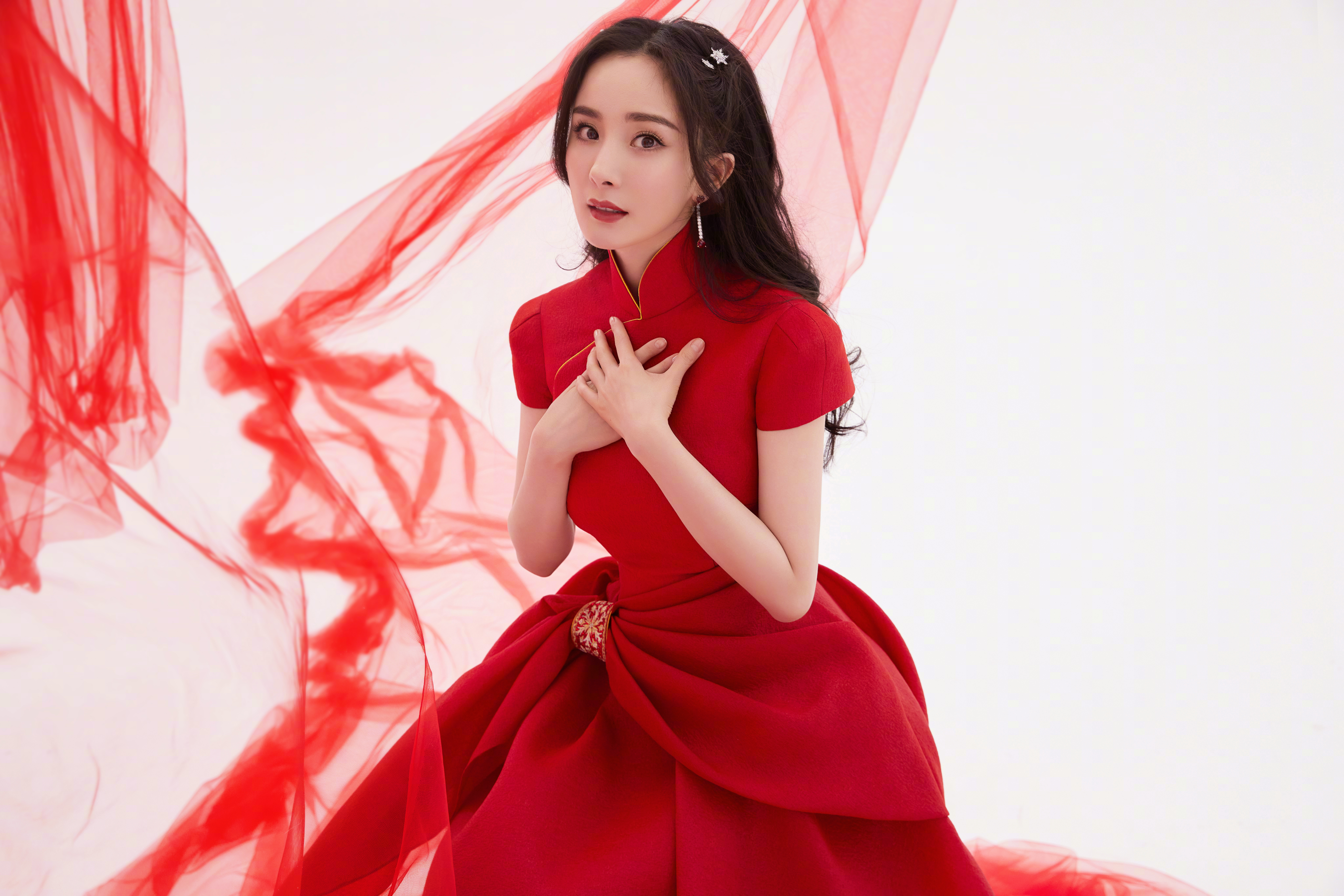 Actress Yang Mi wears a bespoke dress by Guo Pei, and Jimmy Choo heels for the Spring Festival Gala 2021.