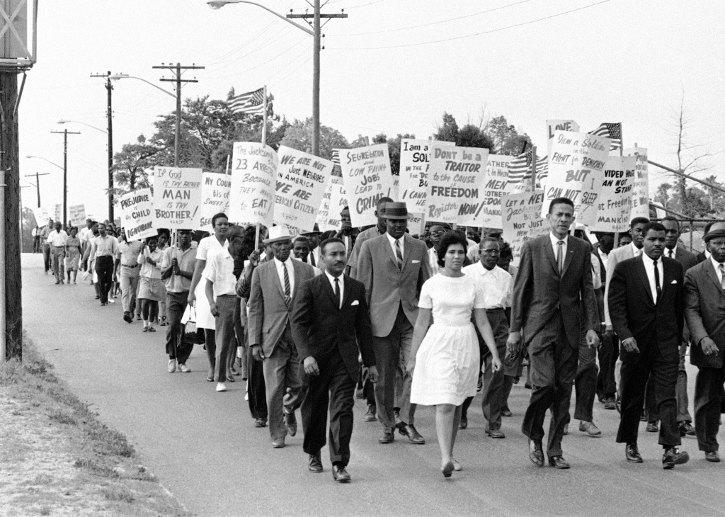 Members of the NAACP march to emphasize their integration demands in Jacksonville, Florida, April 22, 1964.