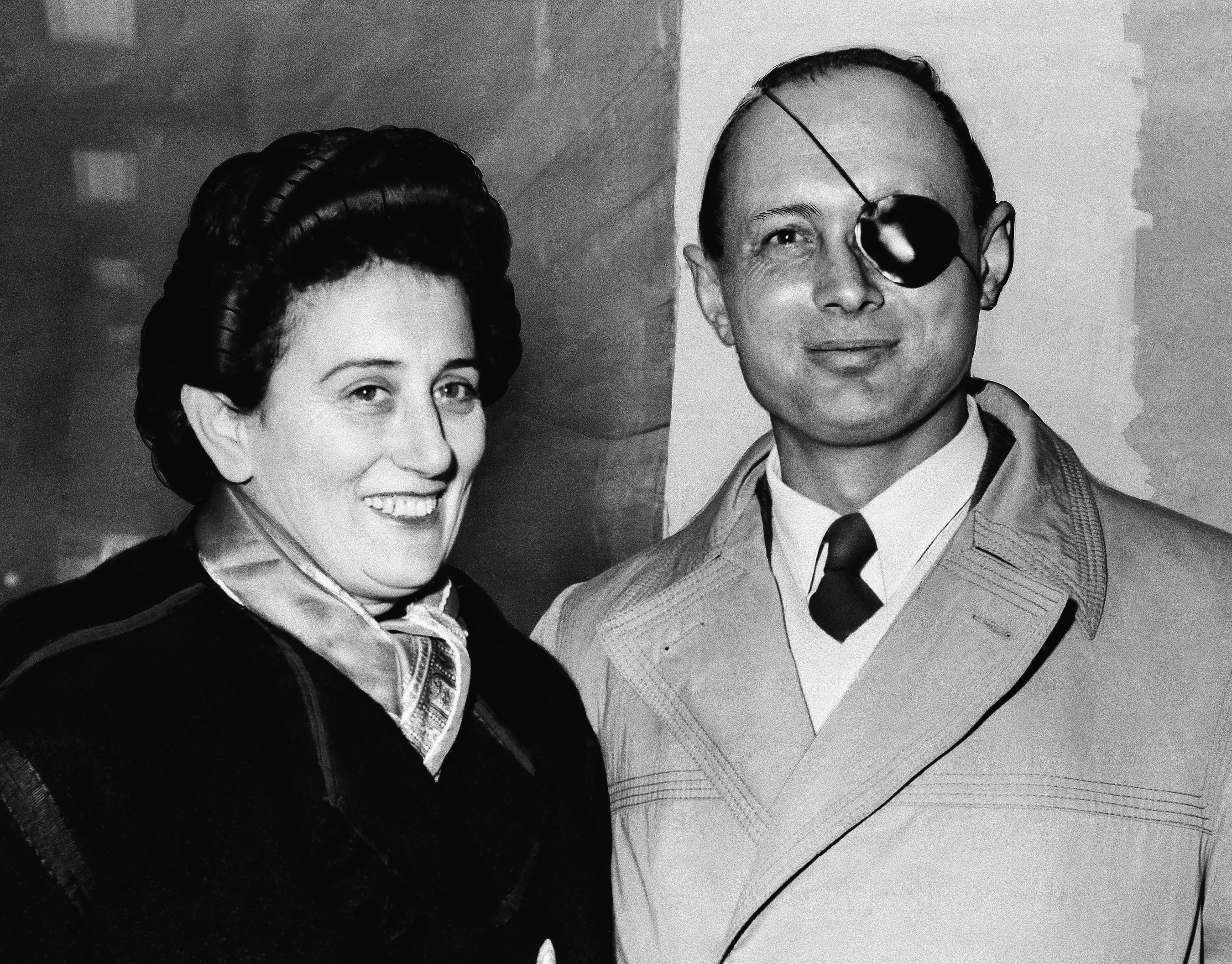 FILE - In this Jan. 13, 1958 file photo, Ruth Dayan stands with her husband, General Moshe Dayan, chief of staff of the Israeli Army, at London Airport.  Ruth Dayan, the Israeli fashion designer and peace activist has died at the age of 103, Israeli media reported Friday, Feb. 5, 2021. (AP Photo, File)