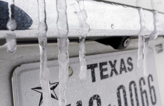Icicles hang on the back of a vehicle Monday, Feb. 15, 2021, in Houston. A frigid blast of winter weather across the U.S. plunged Texas into an unusually icy emergency Monday that knocked out power to more than 2 million people and shut down grocery stores and dangerously snowy roads. (AP Photo/David J. Phillip)