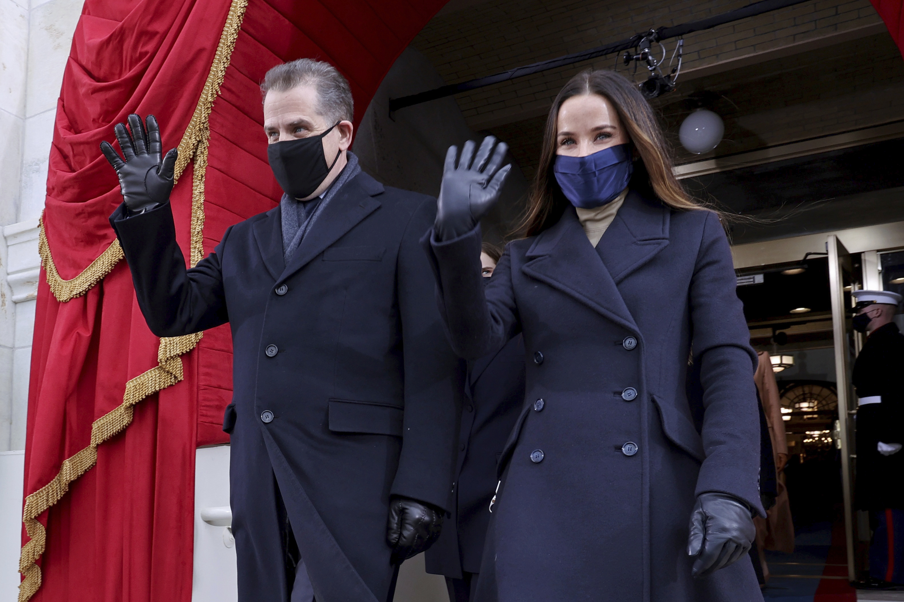 The son and daughter of President-elect Joe Biden, Hunter and Ashley, wave as they arrive to attend the 59th Presidential Inauguration.