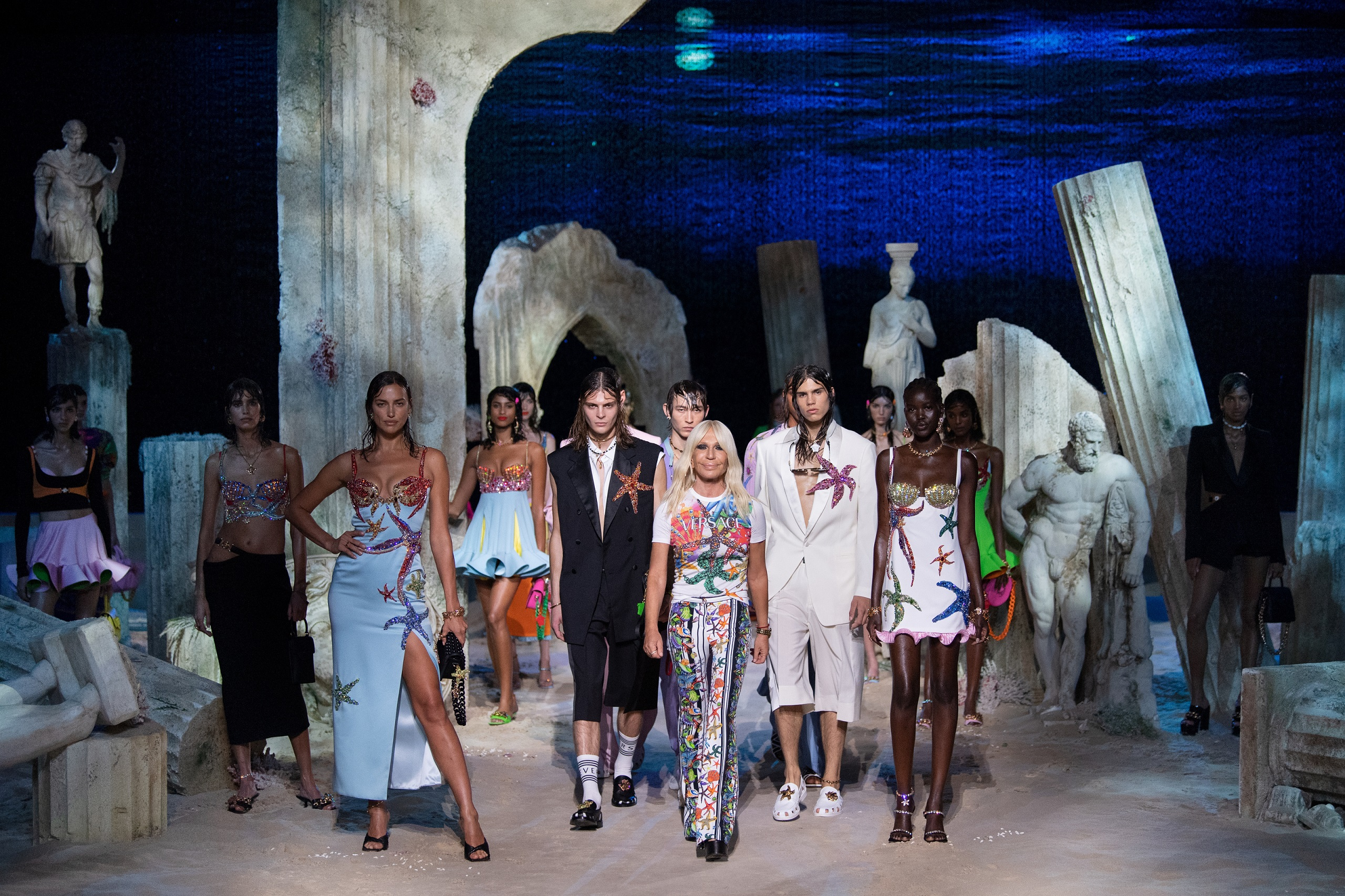 Donatella Versace posing with models on the set of the Versace spring 2021 runway show