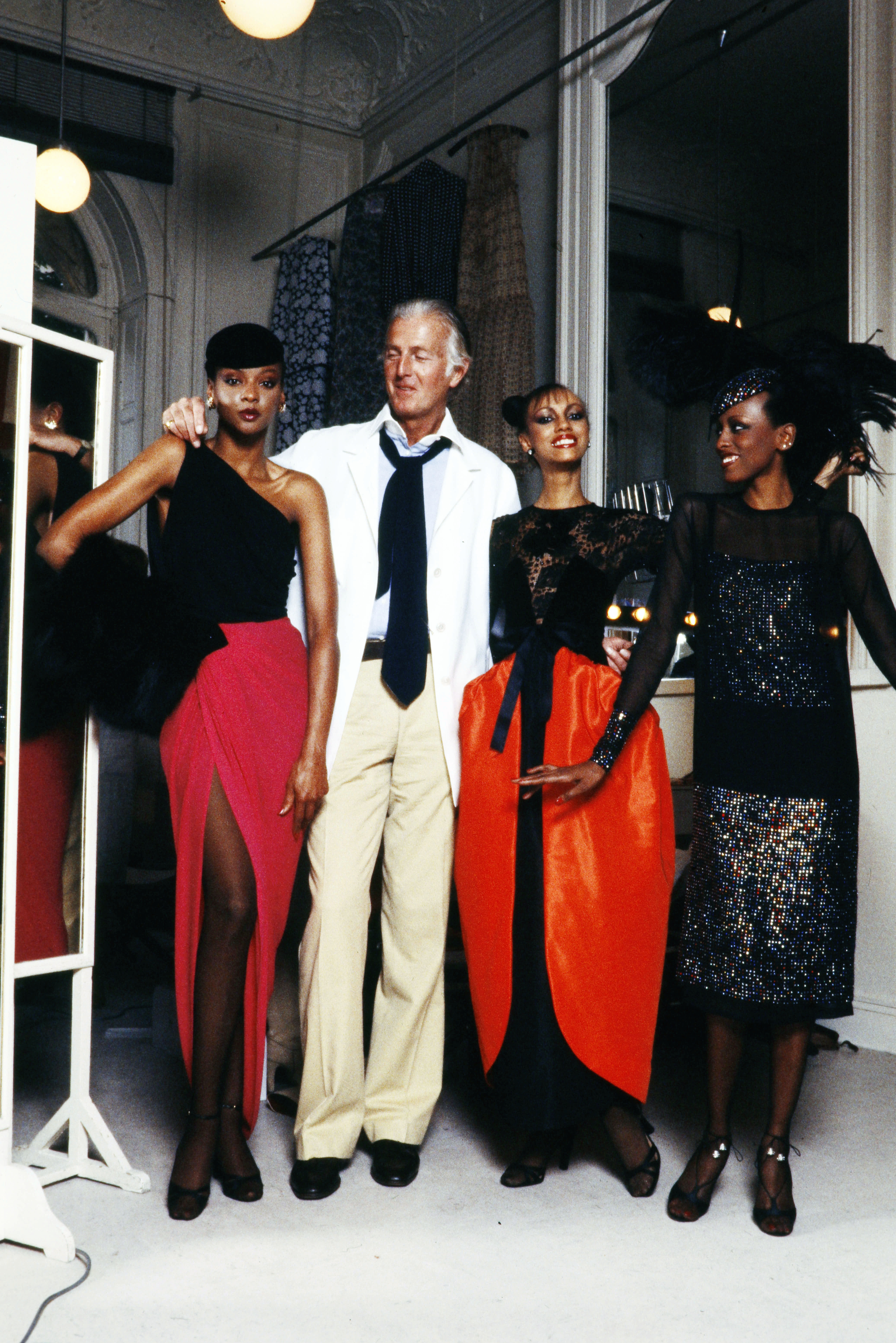 Designer Hubert de Givenchy with models Carol Miles (L) Sandy Bass and Diane Washington wearing Givenchy Fall 1978 Couture