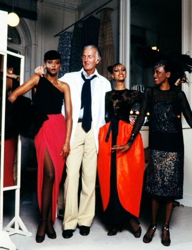 Designer Hubert de Givenchy with models Carol Miles (L) Sandi Bass and Diane Washington wearing Givenchy Fall 1978 Couture Collection Advance.