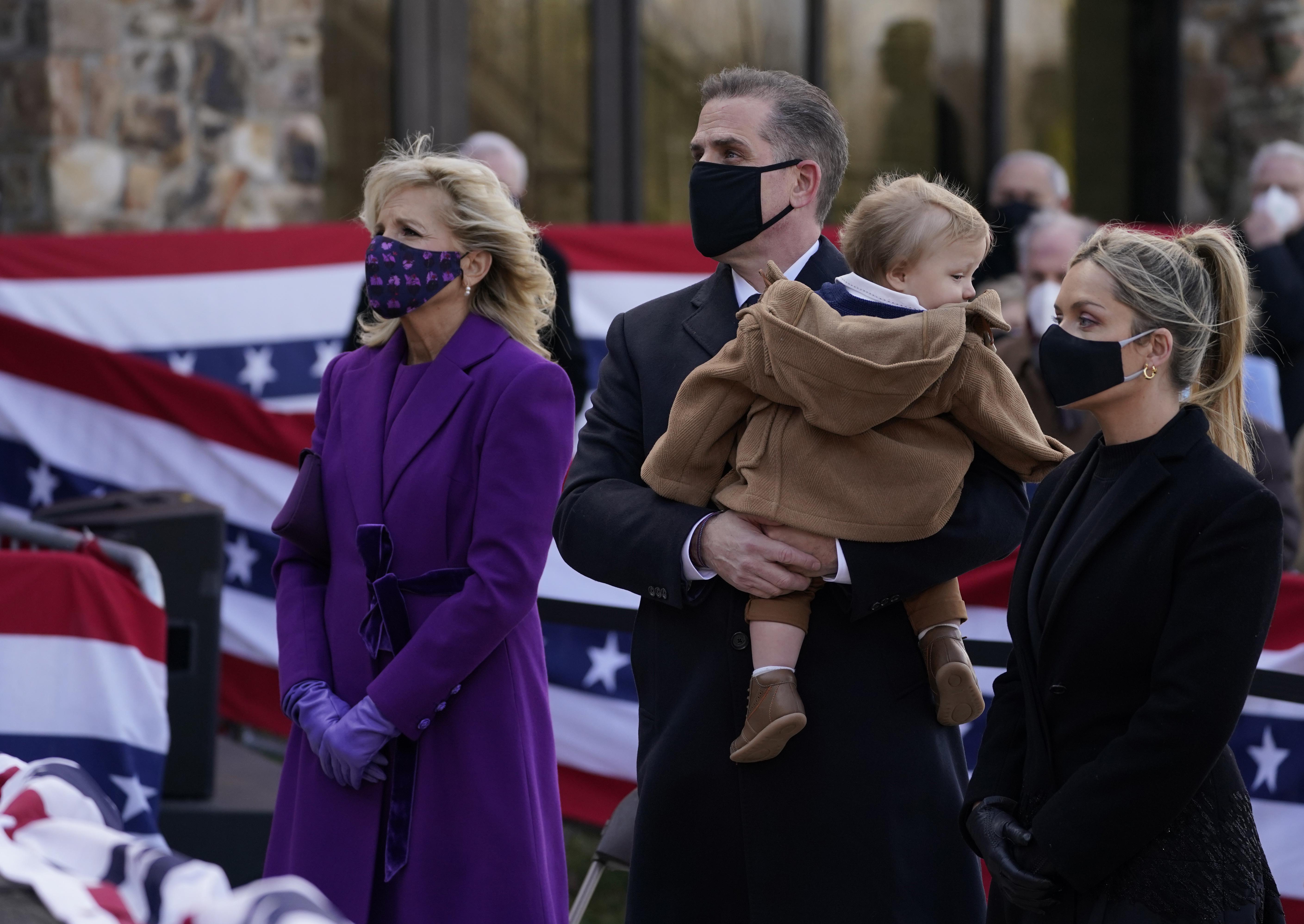 """President-elect Joe Biden's wife Jill Biden stands with Hunter Biden and Melissa Cohen, as they attend an event at the Major Joseph R. """"Beau"""" Biden III National Guard/Reserve Center."""