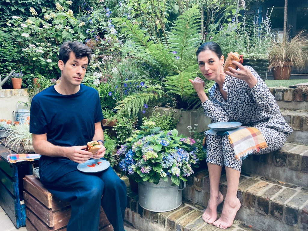 Mary McCartney and Mark Ronson together sitting in the garden eating