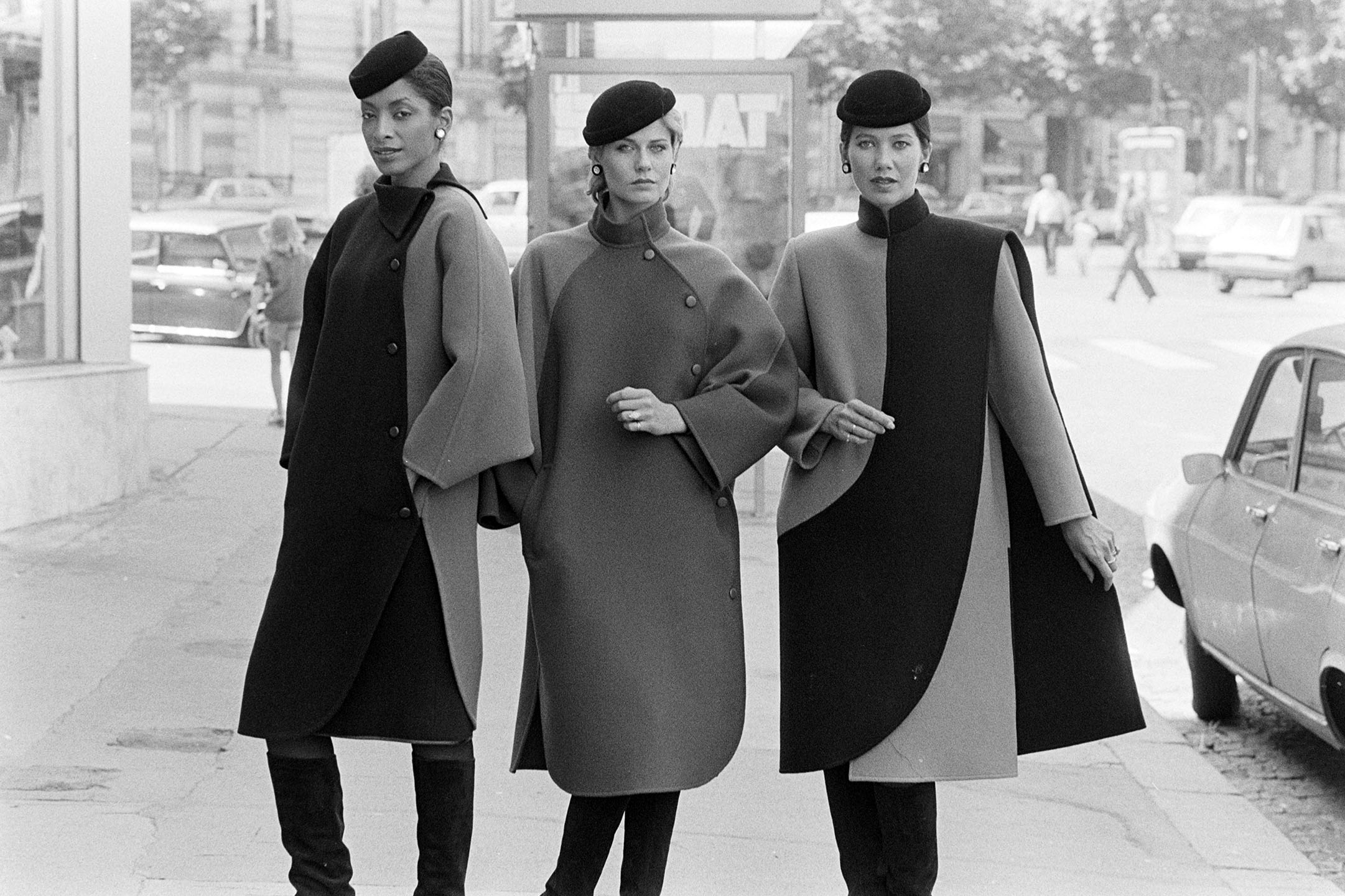 Models pose in coats from Philippe Venet's Fall 1982 Couture Collection Advance.