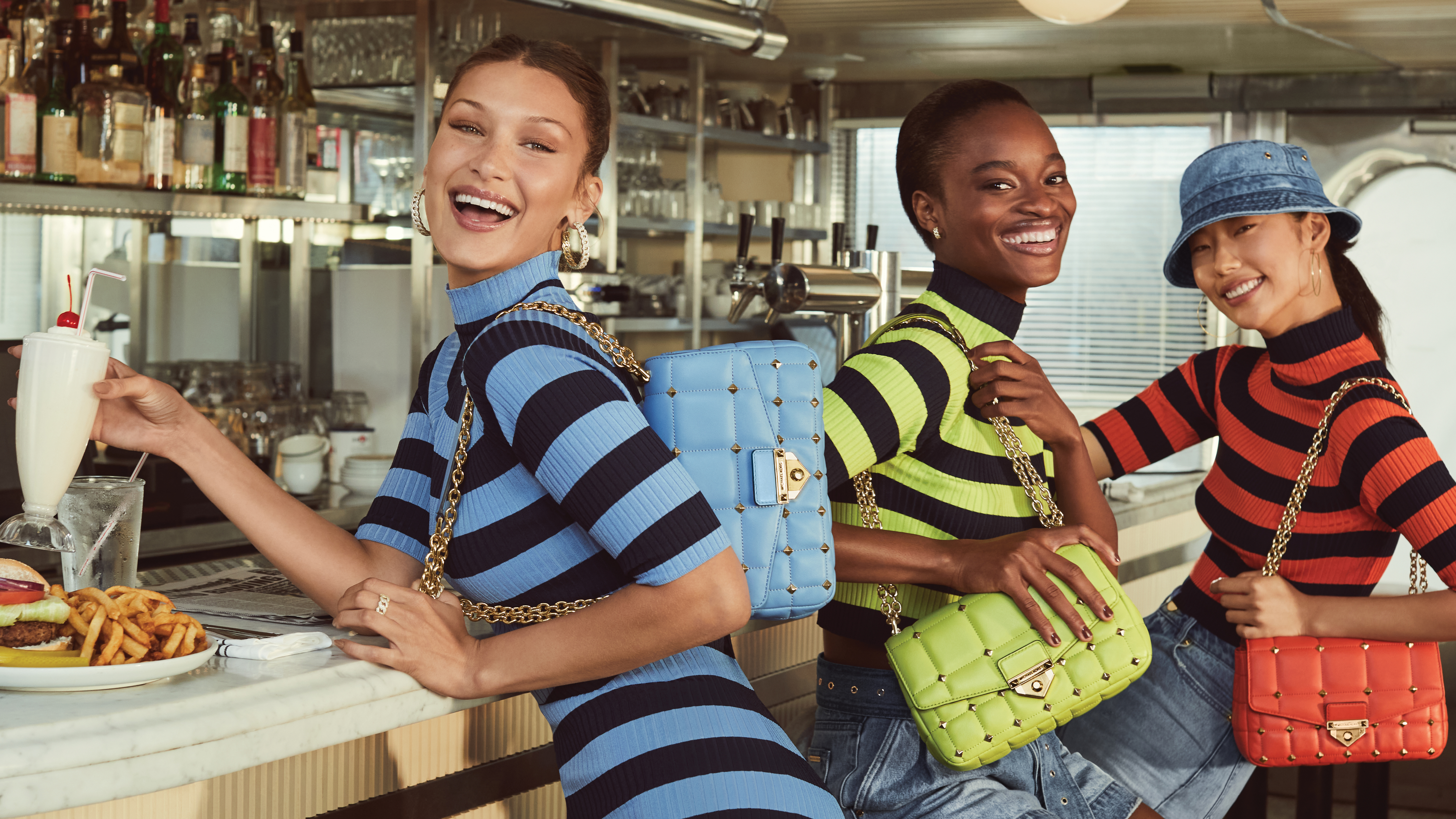 Bella Hadid, Mayowa Nicholas and Heejung Park featured in the MICHAEL Michael Kors campaign.
