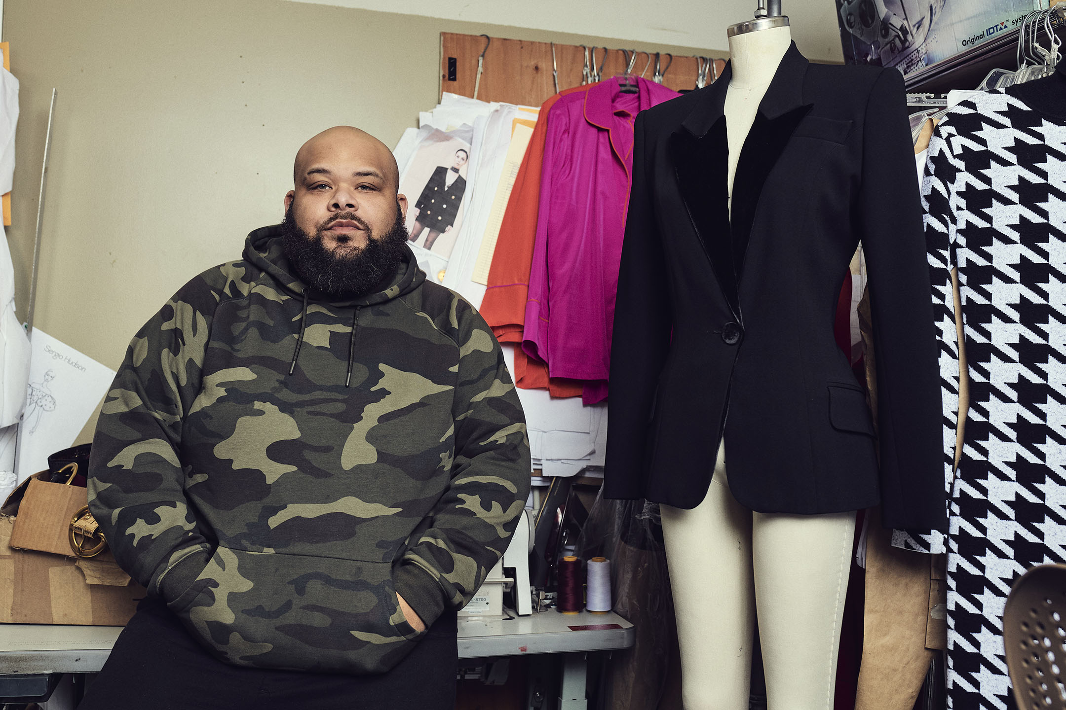 Designer Sergio Hudson and one of his looks