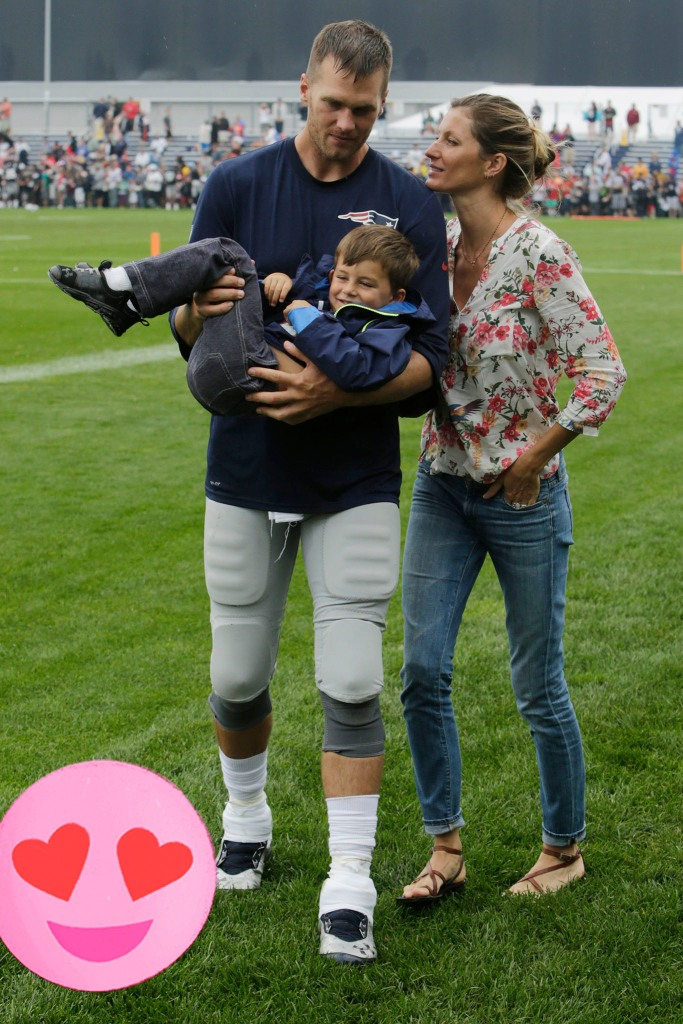 Tom Brady and wife Gisele Bundchen with their son Benjamin Brady after a joint workout with the Tampa Bay Buccaneers at NFL football training camp, 2013.