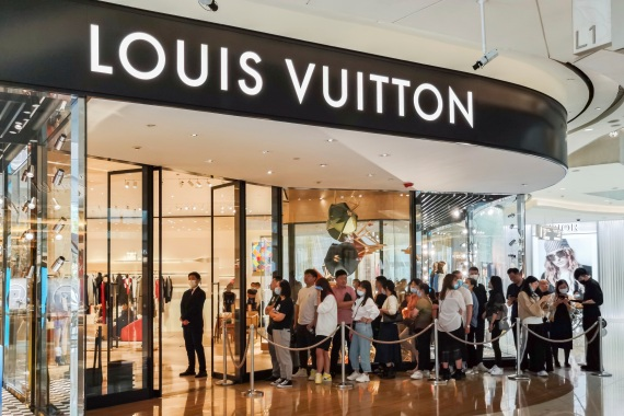 People line up in front of a Louis Vuitton store in Shanghai.