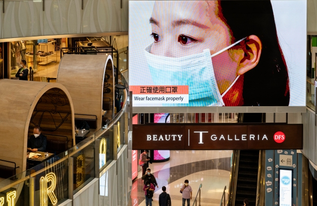 A large-size screen at a shopping mall displaying a video to remind the public about wearing face masks and how to correctly use them as a preventive measure against the spread of Coronavirus officially known as Covid-19 in Hong Kong.