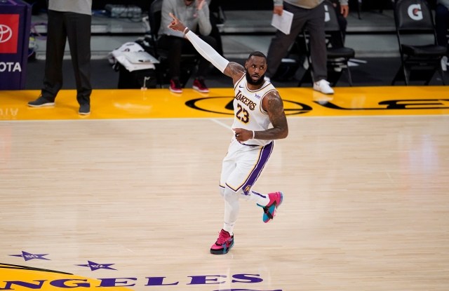 Los Angeles Lakers forward LeBron James (23) signals during the first half of an NBA basketball game against the Atlanta Hawks Saturday, March 20, 2021, in Los Angeles. (AP Photo/Marcio Jose Sanchez)