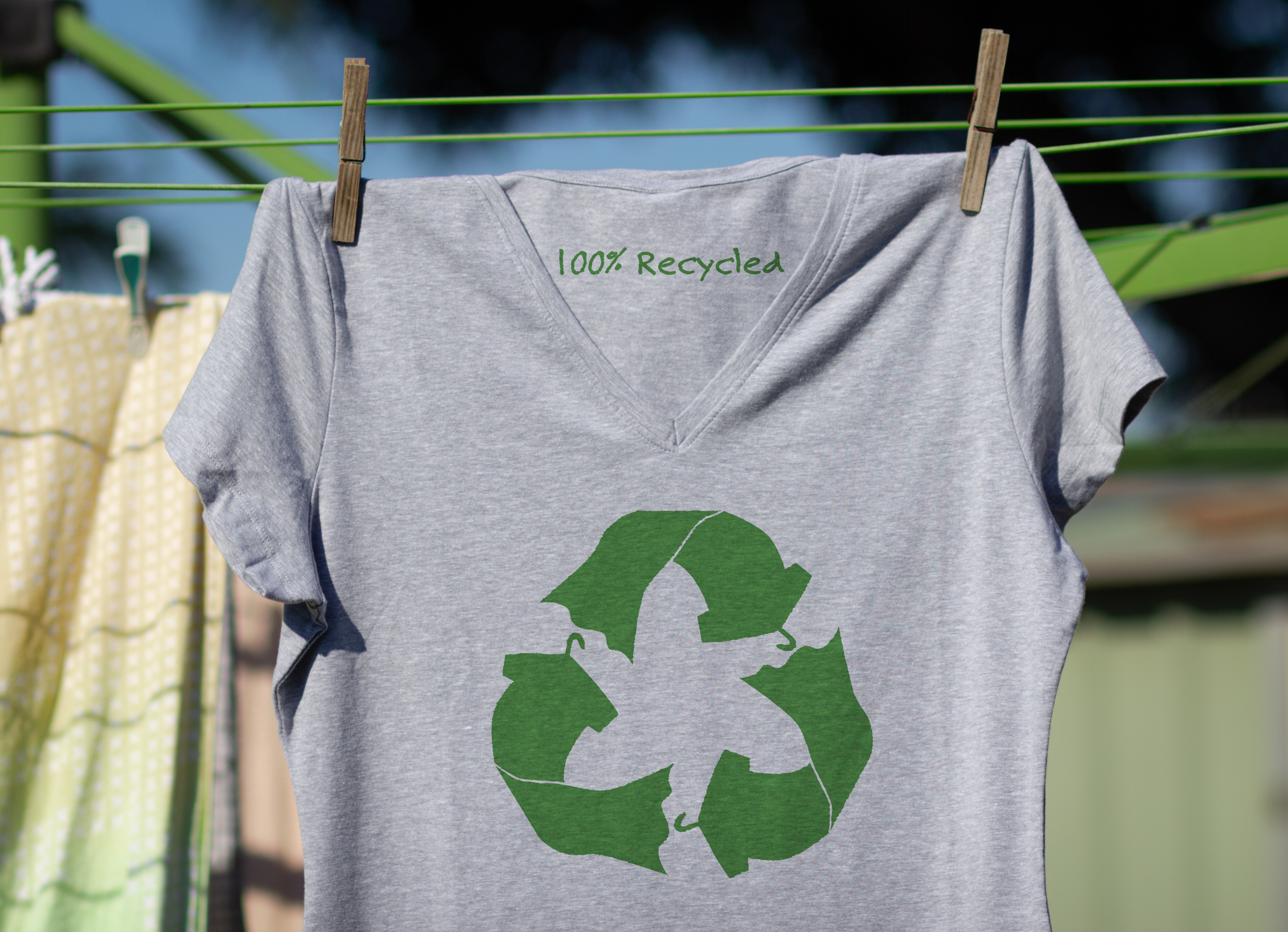 Recycle clothes icon on t shirt