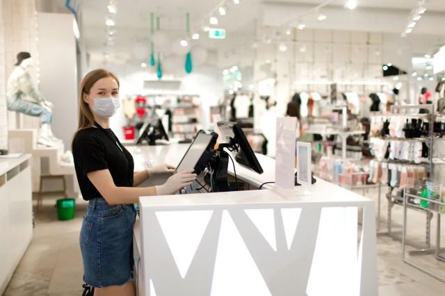 woman sales associate in mask