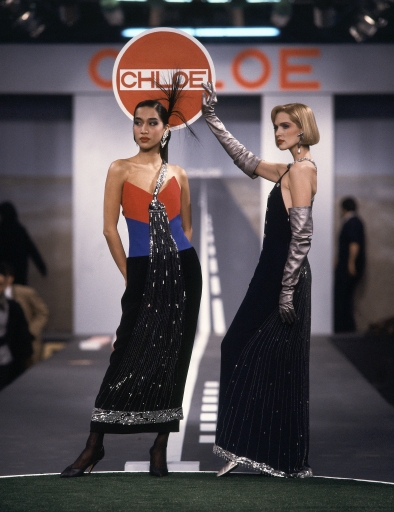 Models wearing splashy beaded faucet dreses in silk crepe on the runway of Karl Lagerfeld's Fall 1983 Ready-To-Wear collection for Chloe on March 21, 1983 in Paris, France.