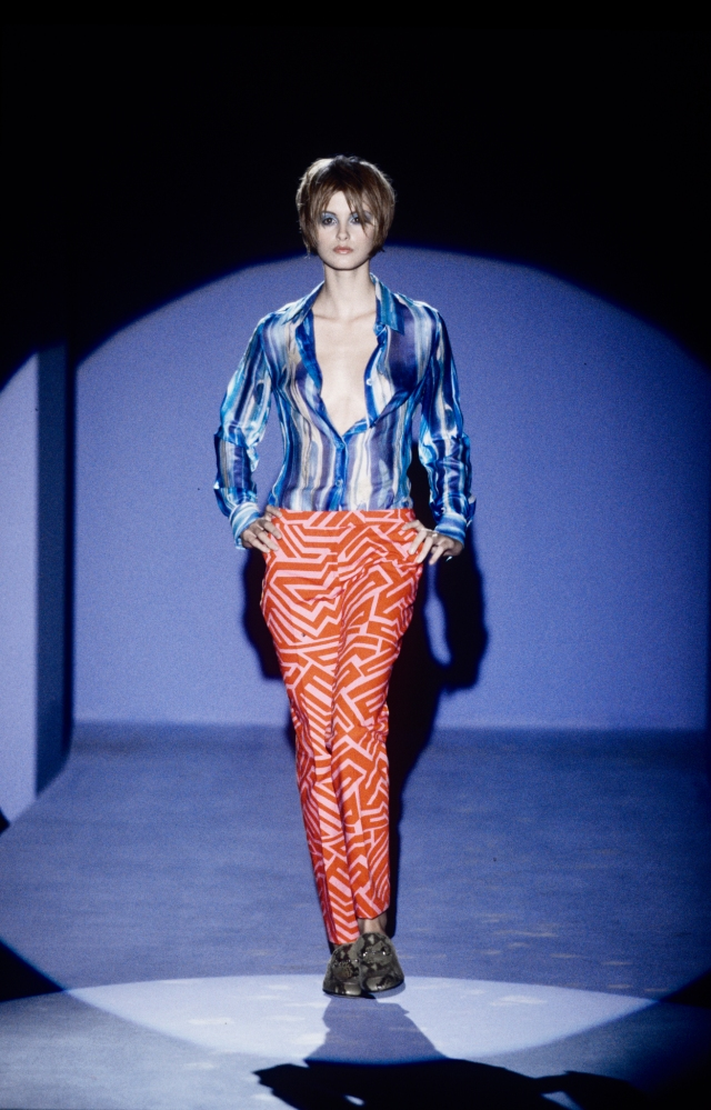 Contrasting pattern ensemble of blue striped blouse and geometric print coral pants from Gucci's Spring/Summer 1996 collection by Tom Ford