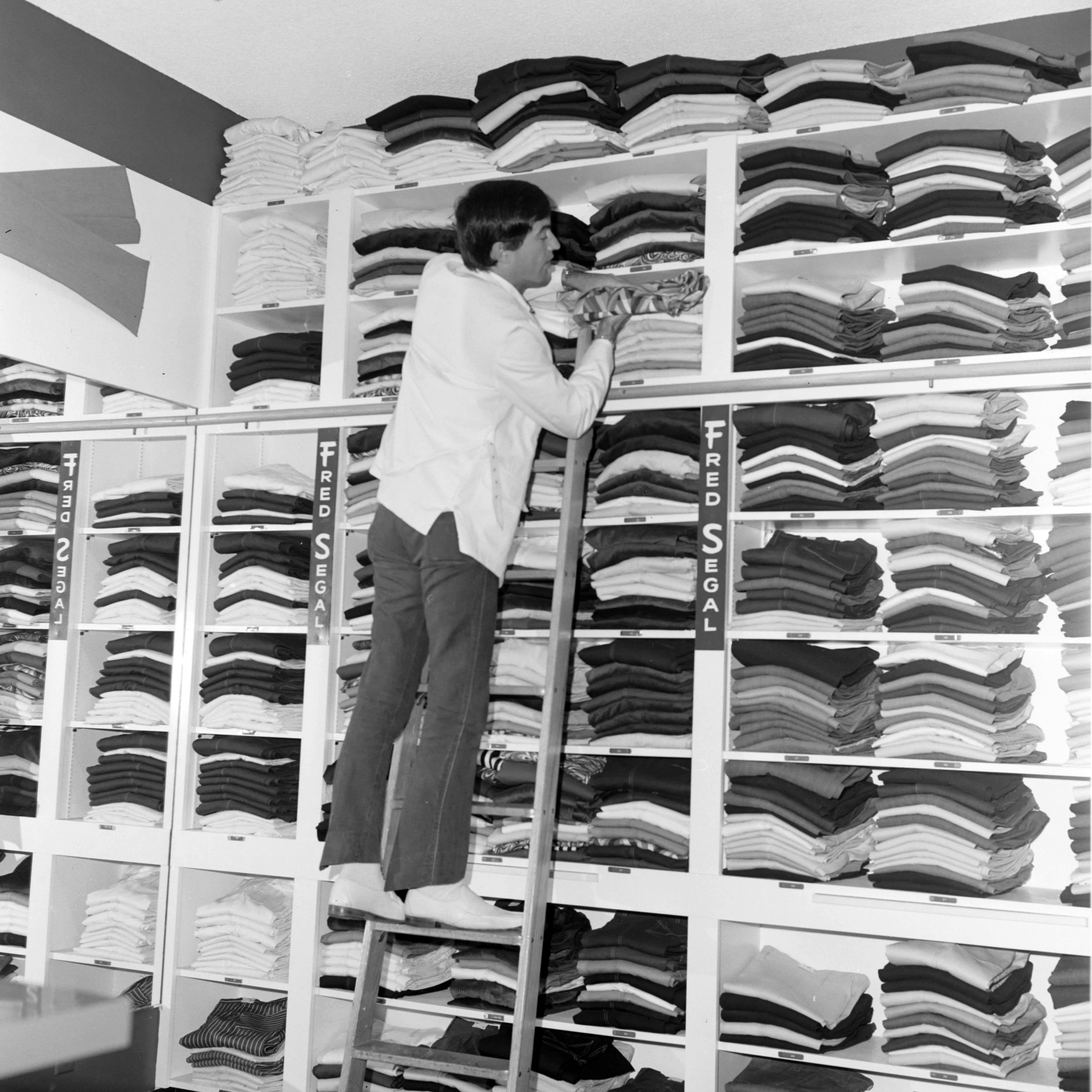 Retailer Fred Segal poses for portraits and restocks the shelves at his new Fred Segal jeans store at 8100 Melrose Avenue in Los Angeles, 1968.