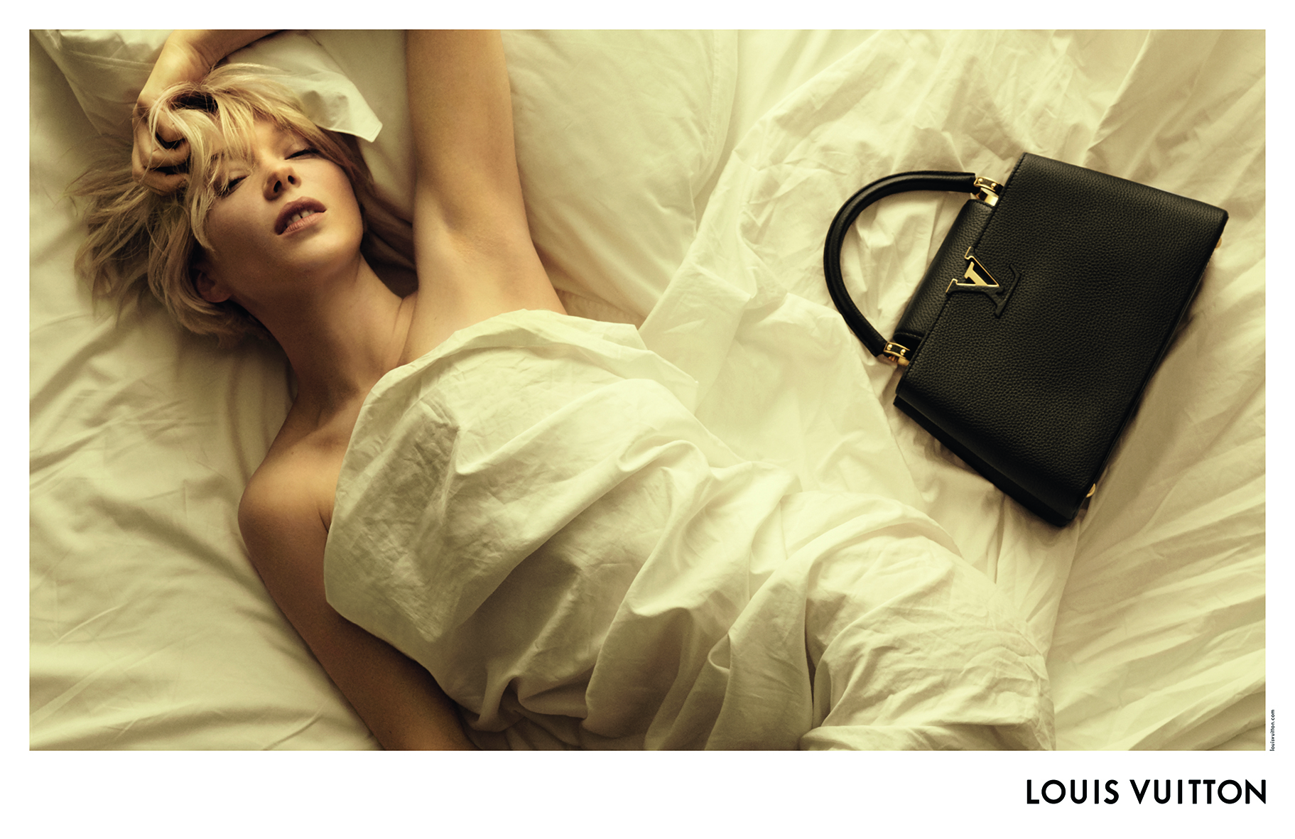 Léa Seydoux in the Louis Vuitton campaign for the Capucines handbag.