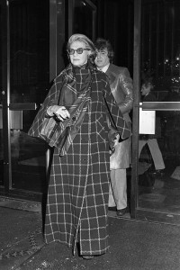 "Designer Pauline Trigere in a floor-length windowpane plaid coat at a screening of ""The Day of the Dolphin"" at the Ziegfeld Theater in New York, 1973."