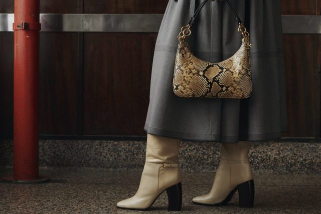 Tan boot and crescent bag from Tory Burch fall 2021.