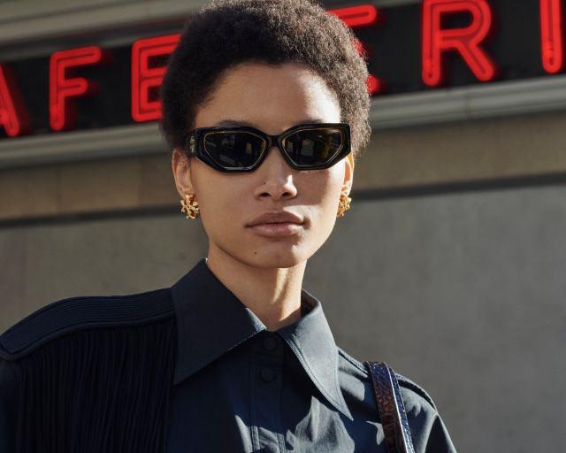 Geometric Kira sunglasses and Kira's stud earring from Tory Burch fall 2021.