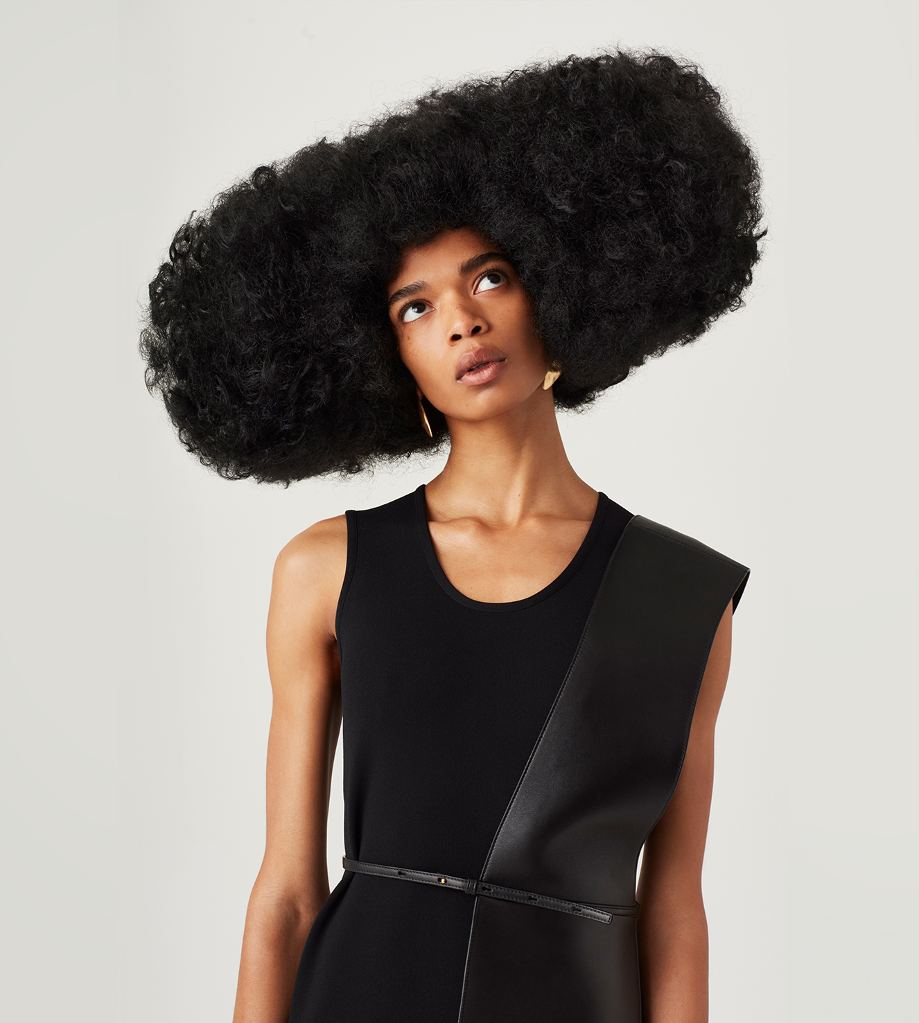 Jill Sander's viscose knit dress and leather belt.
