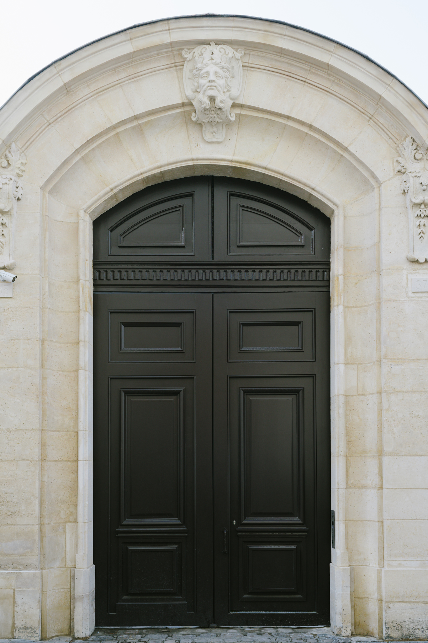 The grand entrance at 35-37 Rue des Francs-Bourgeois