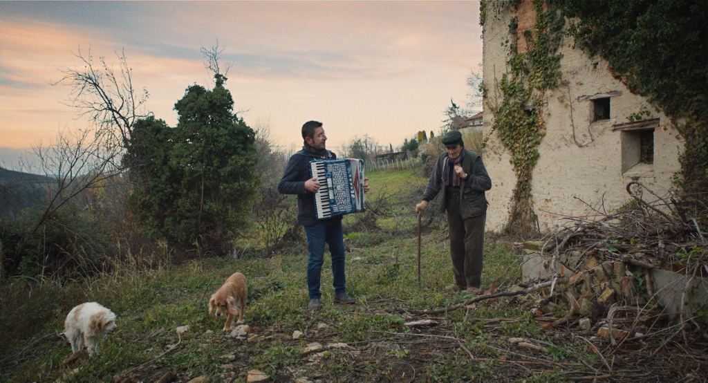 Birba (dog), Aurelio Conterno in THE TRUFFLE HUNTERS Image by Michael Dweck and Gregory Kershaw.