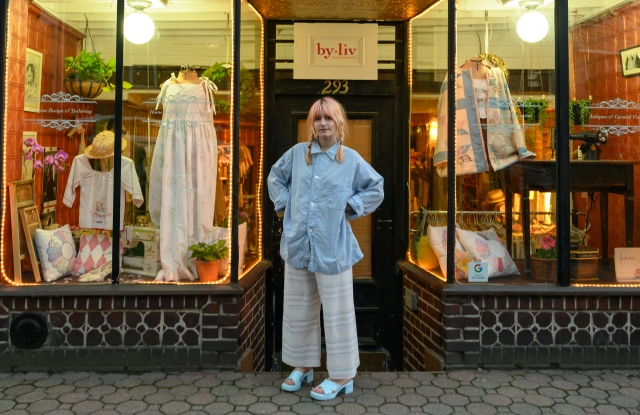 Olivia Reinertson in front of the store for her brand, By Liv.