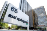 ** FILE ** This May 2, 2007 file photo shows an exterior view of the Axel Springer publishing house in Berlin. German newspaper and magazine publisher Axel Springer AG said Thursday, May 29, 2008 that its first-quarter net profit jumped more than tenfold on the sale of a stake in broadcaster ProSiebenSat.1. (AP Photo/Michael Sohn)