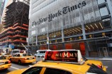 FILE - In this July 22, 2008 file photo, traffic passes in front of The New York Times building in New York. The New York Times says it will charge readers for full access to its Web site starting in 2011, a risky move aimed at drawing more revenue online without driving away advertisers that want the biggest possible audience.(AP Photo/Mark Lennihan, file)