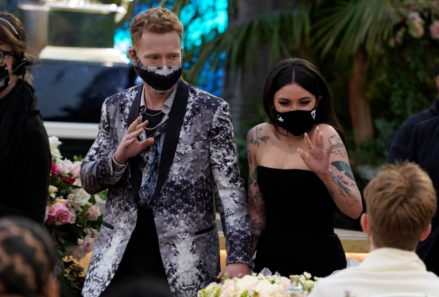 JP Saxe, left, and Julia Michaels appear in the audience at the 63rd annual Grammy Awards at the Los Angeles Convention Center on Sunday, March 14, 2021. (AP Photo/Chris Pizzello)