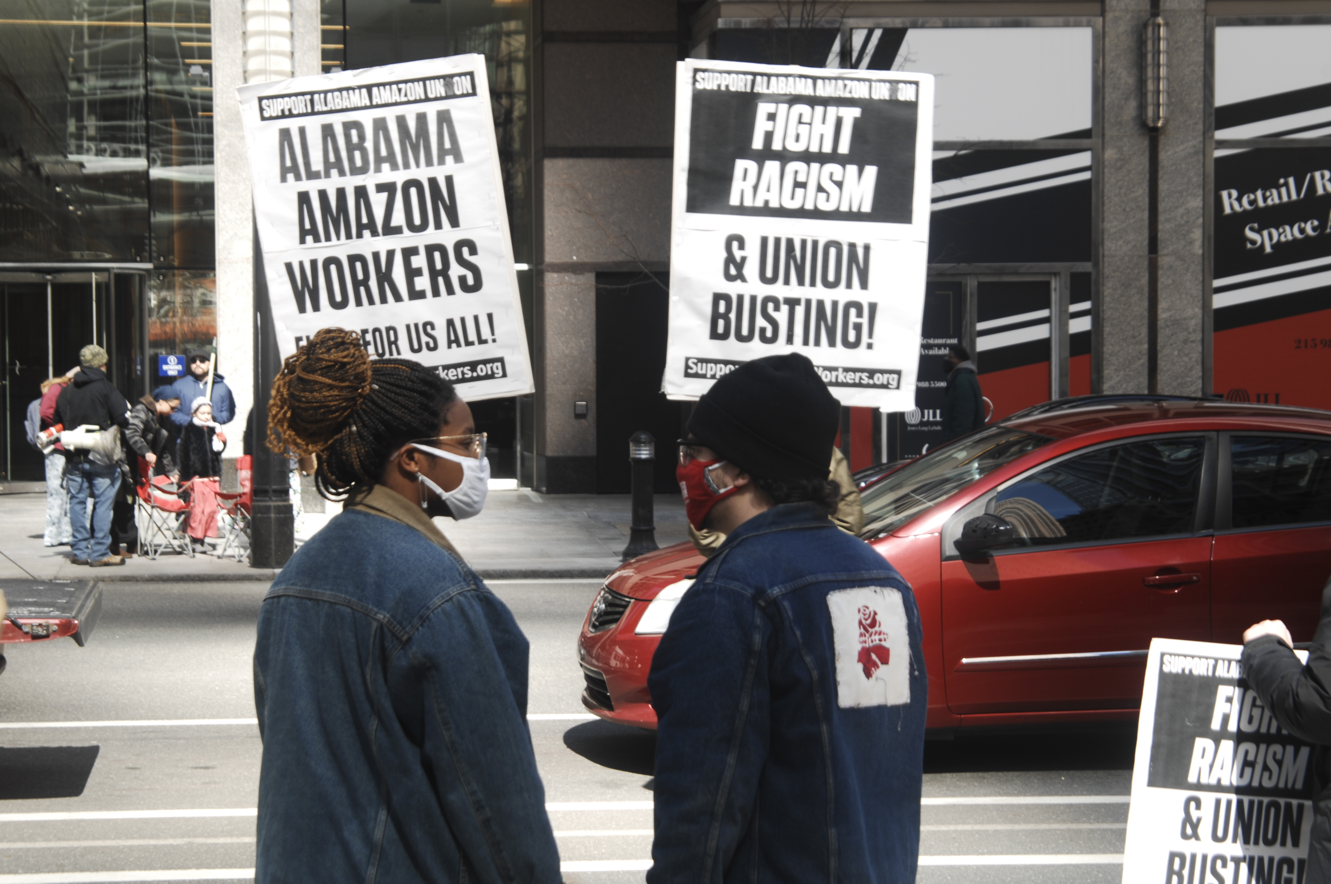 Protesters rally support from drivers as they pass by a rally in support of unionizing Amazon workers in Bessemer, Alabama in front of the law office of Morgan and Lewis during a national day of action in Philadelphia, PA, on March 20, 2021. Morgan and Lewis are known for their union-busting activities and are assisting Amazon in its efforts to bust up the unionizing efforts in Bessemer, Alabama. (Photo by Cory Clark/NurPhoto via AP)