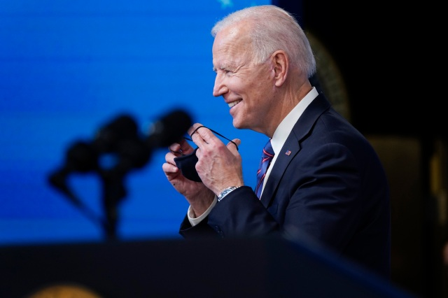 President Joe Biden puts on his face mask after speaking during an event to mark Equal Pay Day in the South Court Auditorium in the Eisenhower Executive Office Building on the White House Campus Wednesday, March 24, 2021, in Washington. (AP Photo/Evan Vucci)