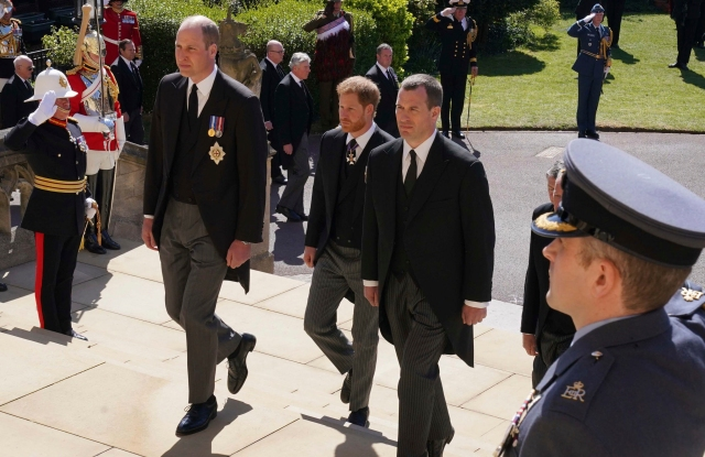 Prince William, Prince Harry and Peter Phillips, from right, follow the coffin into St George's Chapel during the procession of Britain Prince Philip's funeral at Windsor Castle, Windsor, England, Saturday April 17, 2021. Prince Philip died April 9 at the age of 99 after 73 years of marriage to Britain's Queen Elizabeth II. (Arthur Edwards/Pool via AP)