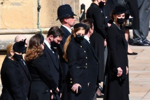 Members of the funeral party wait for the procession ahead of Britain Prince Philip's funeral at Windsor Castle, Windsor, England, Saturday April 17, 2021. Prince Philip died April 9 at the age of 99 after 73 years of marriage to Britain's Queen Elizabeth II. (Jeremy Selwyn/Pool via AP)