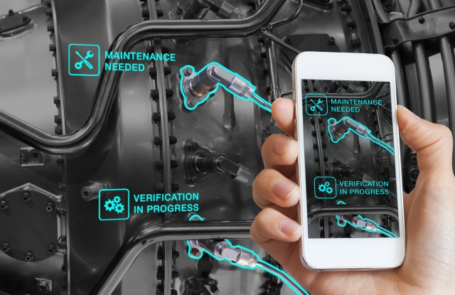 Augmented Reality technology maintenance and service of mechanical parts, technician using smartphone with AR interface on screen in smart industry, automated monitoring process